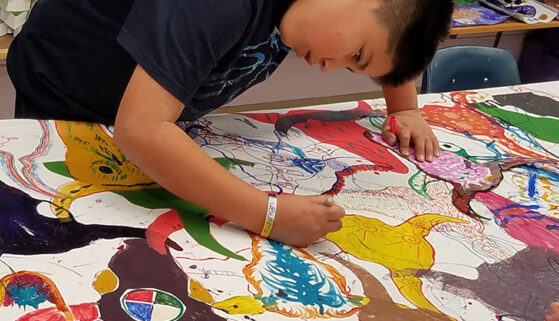 Students work together on an art project.
